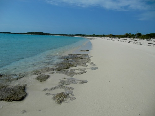 We walk along the stunning beach at Racoon Cay