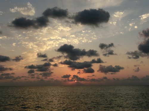The sun goes down on Racoon Cay